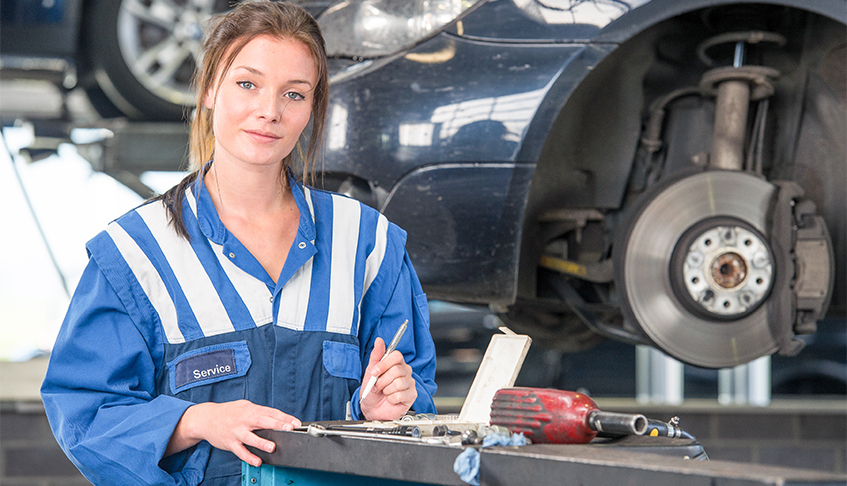 Female Mechanic getting tools out