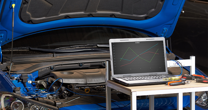 Computer connected to car engine